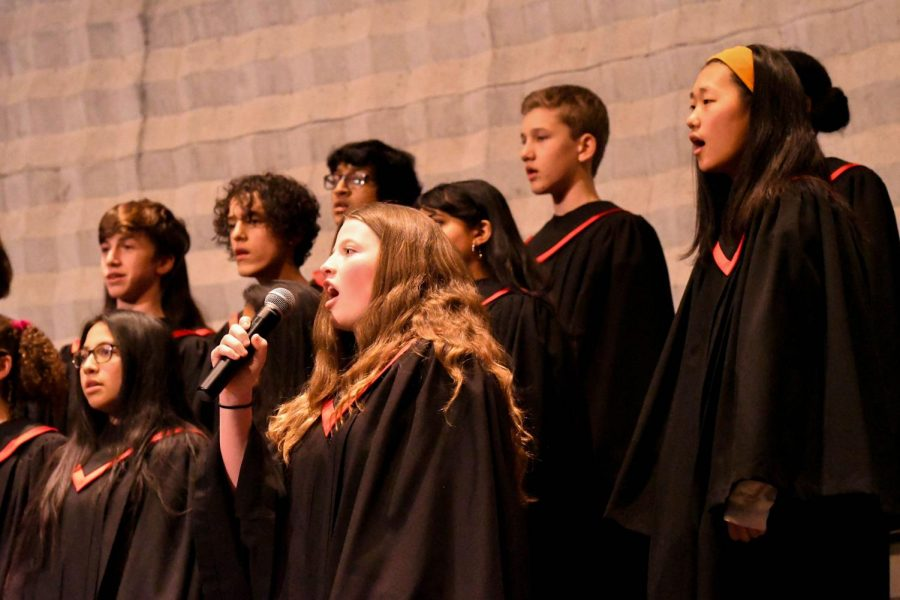Ninth-grader+Clare+O%27Connor+sings+a+solo+for+a+choir+performance+at+the+2020+Martin+Luther+King+Jr.+Assembly.+While+many+simply+use+choir+to+fulfill+the+music+requirement+for+graduation%2C+some+continue+into+Bel+Canto+or+other+music+classes+afterward.