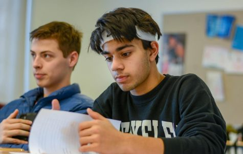Juniors Rohan Shah and Loren Pope listen during a Mock Trial practice in March 2020. Mock Trial was a new club this year, and unfortunately was unable to compete in their first-ever competition because of COVID-19.