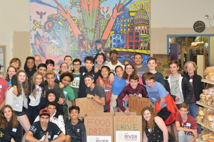 Having taken their first step on their service journey, a group of sophomores poses at their sophomore retreat service site, The River Food Pantry, Sept. 19. Many members of the class of 2022 have had difficulty completing that journey because of COVID-19, leading to the requirement being reduced to 20 hours from 40.