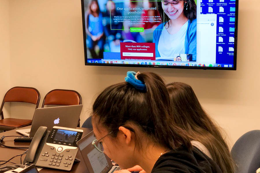 Members of the class of 2020 work on their college materials in the conference room of the Learning and Counseling suite. The class of 2021 is having to navigate this process remotely on account of COVID-19.