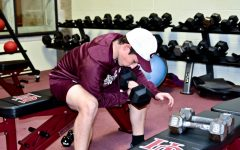 Senior Julian Skosey-LaLonde trains with a dumbbell in the fitness center in October 2019.