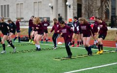 The girls soccer team does warm up drills before practice on March 11, only a few days before the announcement that Lab was to go online. In an effort to stay in touch while also abiding by social distancing measures, the team has bonded in creative ways such as a rock-paper-scissors tournament and other games.