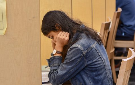 STUDENT STRESS. Riya Chadha studies in the library before remote learning.