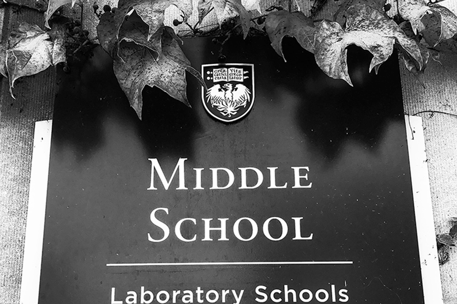 A+sign+outside+of+the+Middle+School+Lobby+is+covered+in+ivy.