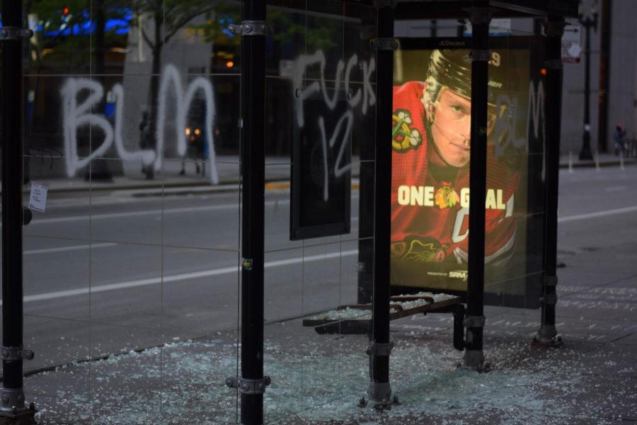 A bus stop with glass walls smashed and covered with graffiti is shown, among countless other vandalized things on the morning of May 31 after protests the day and night before.