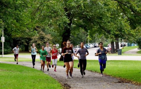 U-High's cross country team runs across Midway Plaisance Park to practice in the fall 2019 season. Cross country is one of the sports that will continue to run practices this fall.