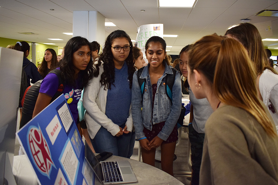 Students gather around a club shopping booth during the 2019-20 school year.