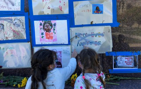 Students in teacher Tracy Aiden's kindergarten class visit their Breonna Taylor memorial at the Masaryk Monument.