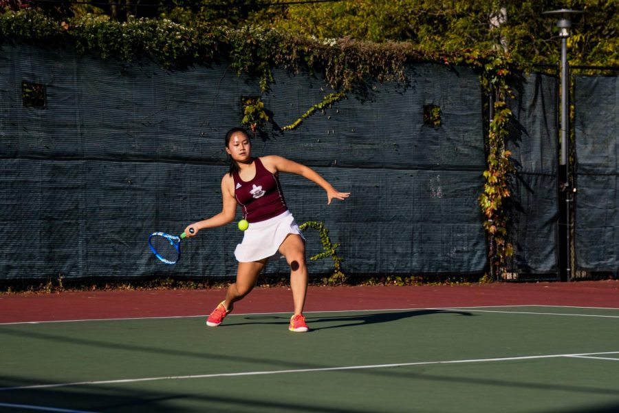 Sophomore+Corona+Chen%2C+focused%2C+prepares+to+swing+her+racket+at+the+ball+in+a+home+match+against+Lake+Forest.