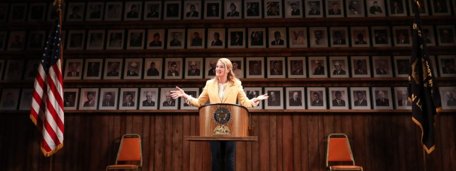 """Photo by Joan Marcus. Heidi Schreck speaks to the audience during a 2019 performance of """"You Be My Ally"""" at The Hayes Theater on Broadway."""