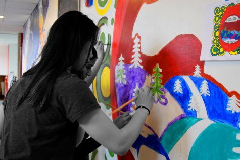 Students paint a mural at last year