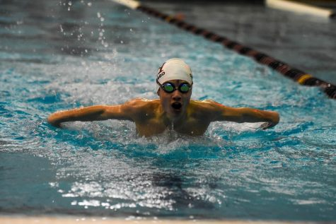 Junior Spencer McKula strides forward across his lane during a Dec. 12, 2019 meet at Latin. Due to continual postponement of winter sports this season, boys swimming has been one of many teams held on standby until further notice.
