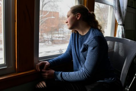 Freshman Elena Bloom gazes out her window awaiting the return to normalcy. While distance learning used to be enjoyable, students long for the days they can escape the monotonous cycle of Zoom classes.