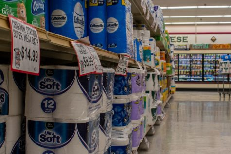 Store emmployee Michael Kinnavy is noticing an alarming rate of toilet paper purchases at Kramer Foods in Hinsdale in response to rising COVID-19 cases.