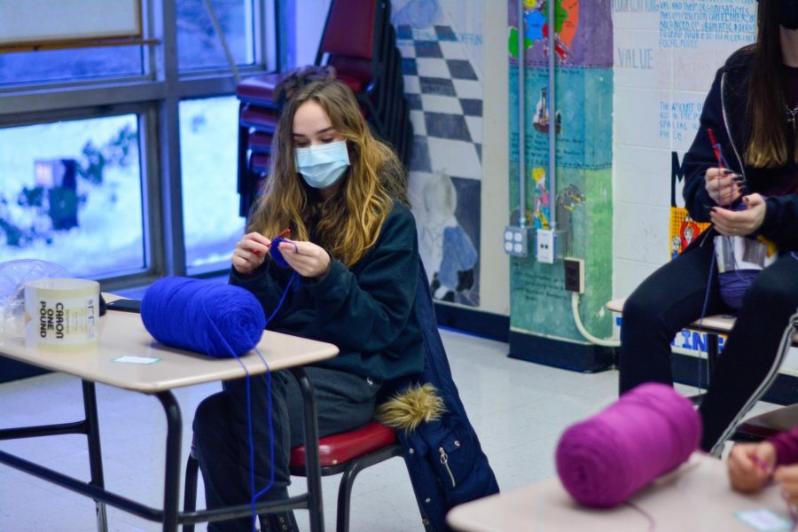 Junior Jessica Slear crochets in an activity at the mixed grade event Feb. 5.