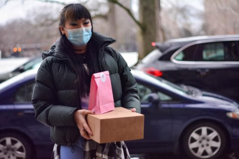 Junior Chloe Ma delivers her baked goods to a customer.