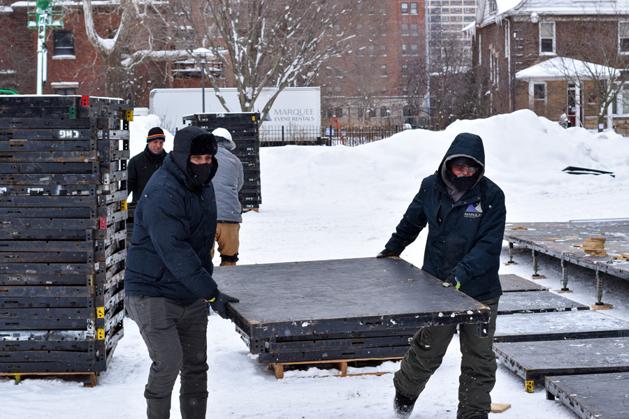 Workers build the new tent on Scammon Garden. After its construction, the tent will have the potential to fit 50 students while adhering to social distancing guidelines.