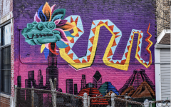 A dragon is painted in vibrant colors on a building in Gage Park, representing just one of many murals in the area.