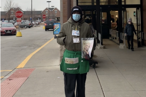 Lee A. Holmes poses outside of a Mariano's in Roscoe Village, holding an old edition of a StreetWise magazine. Having a deep passion for entrepreneurship, StreetWise has provided Mr. Holmes with an opportunity to exhibit and learn new skills by selling the magazine daily.