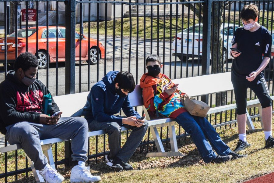 During their first day of hybrid learning, ninth graders spend their lunch on Jackman field.
