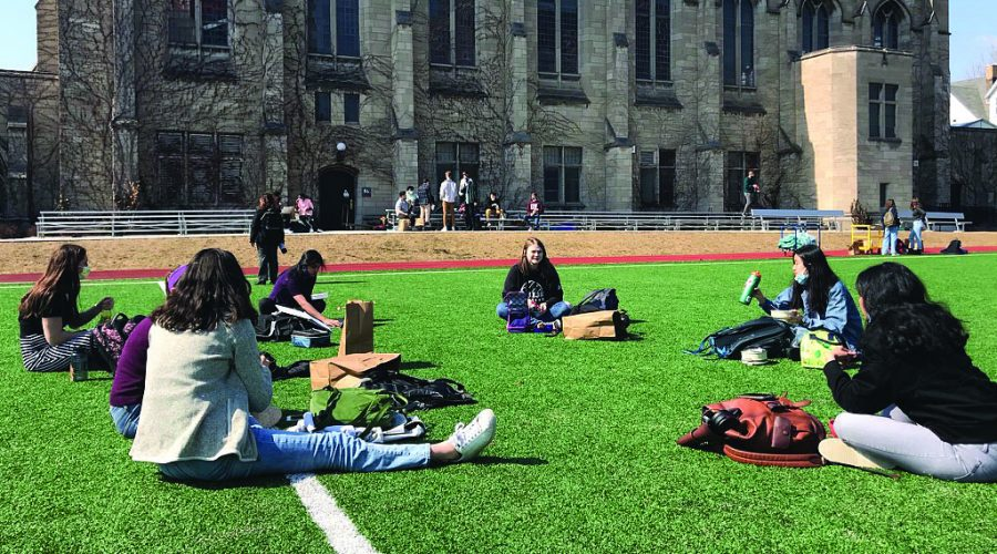 Seniors spread out on Jackman Field during lunch on the first day of school. Students were allowed to choose between Jackman Field, Café Lab and approved rooms for clubs. Most seniors spent the hour on Jackman Field eating, chatting or playing catch with a football. ArtsFest Committee was also distributing materials and T-shirts for March 17.