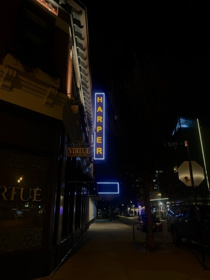 The Harper Theater's sign hovers over an empty street in Hyde Park.