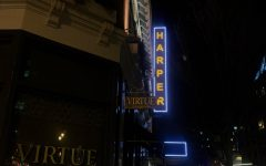 The Harper Theater sign hovers over 52nd Harper Avenue in Hyde Park.