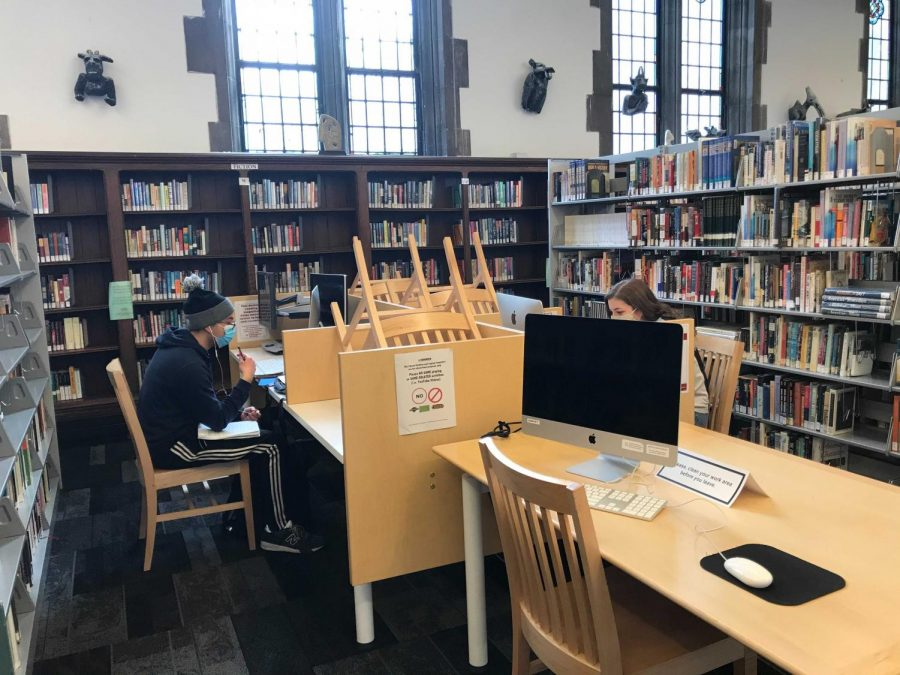 Students work March 9 in the library, which may now hold 26 individuals in the combined main area and corridor spaces.