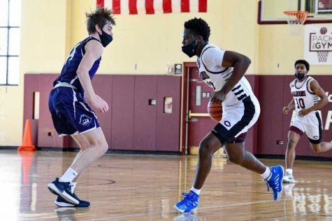 Senior Tolu Johnson faces a player from North Shore Country Day on March 13 with a 65-51 loss. Despite the shortened season, Tolu was glad to have three weeks to spend with his team before they go to different colleges.