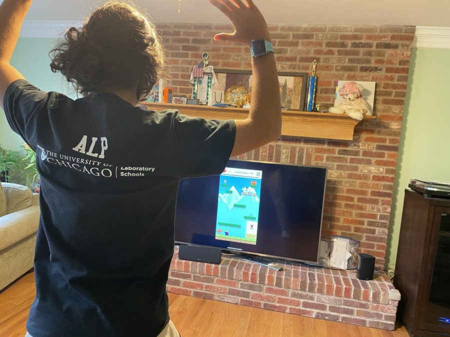 Cache Money member Alp Demirtas plays with RETRO-FIT, a fitness app that incorporates fantasy gameplay, on April 21. The prompt for this years FIRST Global Innovation Challenge was an innovation that improves the mental and physical wellbeing of users.
