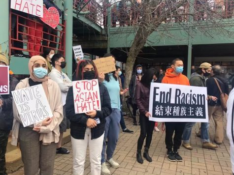 Protestors hold up messages against anti-Asian violence in Chinatown Square on March 27. The protest was in response to the shooting in Atlanta, Georgia killing eight people, including six women of Asian descent.