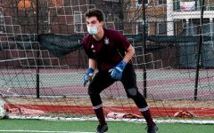 Senior Hunter Heyman keeps a goalie stance while anticipating a shot during a practice at Jackman Field March 3. Heyman's leadership was a key quality in helping the boys soccer team through a challenging season.