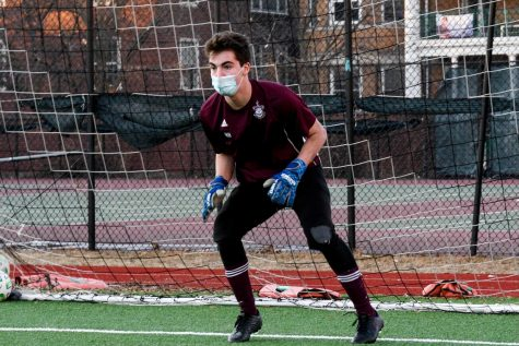 Senior Hunter Heyman keeps a goalie stance while anticipating a shot during a practice at Jackman Field March 3. Heyman