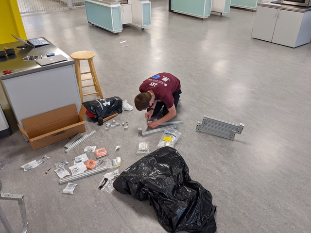 Sophomore Jay works on a building project in Café Lab for the robotics team. In addition to designing robots for competition, the team began sharing their passion through volunteering and working with other organizations.