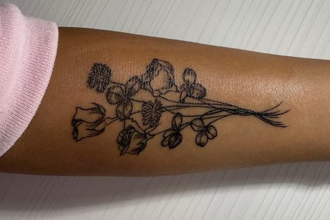 Senior Maya Patel shows the tattoo on her forearm