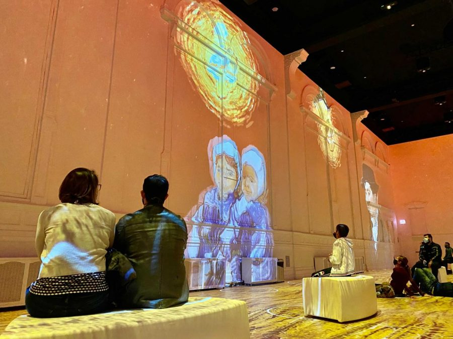 Guests watch as Van Gogh's works appear in bursts of color on the walls of the