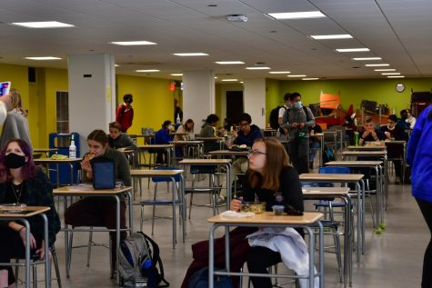 Students in grades 9-11 eat lunch in the cafeteria May 10. Sophomore Anokha Nathan was both excited and concerned about attending school in person with three grades after more than a year.
