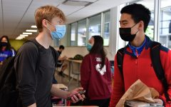 Juniors Andrew Swinger and Todd Hao converse during lunch May 10. Andrew found the return with 9-11 graders different but appreciated seeing familiar faces.
