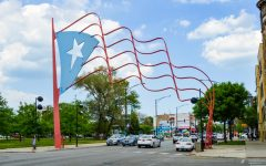 Steel Puerto Rican flags stand at each end of a portion of Division street called