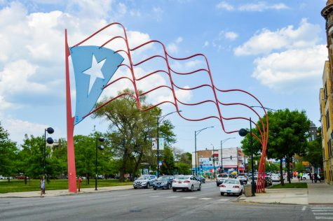 Steel Puerto Rican flags stand at each end of a portion of Division street called Paseo Boricua, which translates to Puerto Rican promenade.