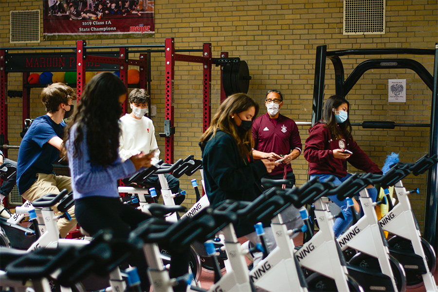 Sophomores ride stationary bikes in the fitness center during gym class May 10. The available time slots to use the fitness center are 3:30-4:20 p.m. and 4:30-5:20 p.m. on Tuesdays and Thursdays.