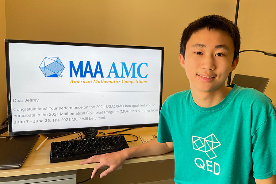 Sophomore Jeffrey Chen poses next to his acceptance letter to the Mathematical Olympiad Program. The Mathematical Olympiad Program is an elite training program for competition math typically held at  Carnegie Mellon University but will be virtual this year due to the coronavirus pandemic.