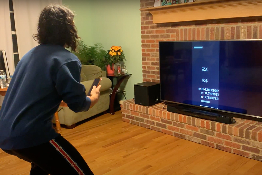 Cache Money member Alp Demirtas plays with RETRO-FIT, a fitness app that incorporates fantasy gameplay that the team designed, on April 21.