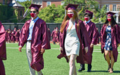 MAKING IT THROUGH. Members of the Class of 2021 walk through Jackman Field during the recessional after being declared graduates.