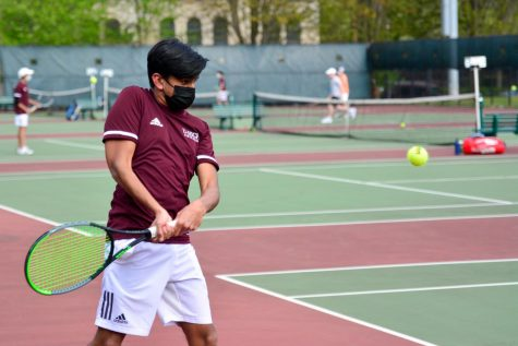 Junior Sid Shah competes against Lake Forest Academy on April 27. The boys tennis team advanced to state, sending two singles and two doubles teams.
