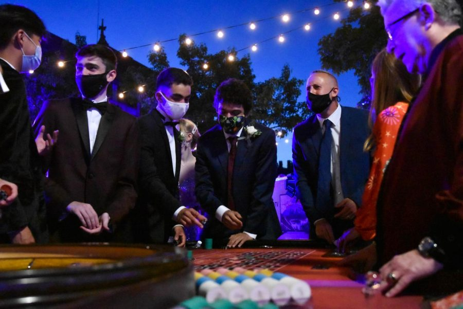 """Playing for a prize. Seniors play roulette to win raffle tickets. Poker, blackjack and craps were also available, and students traded their tokens for raffle tickets. """"I'm glad something was put together,"""" Avi Keysar said. """"The main thing is that we got to see each other and celebrate together."""""""