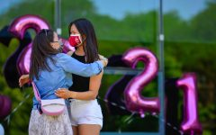 """History teacher Holly Johnston, left, hugs Elizabeth Lin, who had just recognized Ms. Johnston on behalf of the Class of 2021 for the impact she had on students. """"She challenged us intellectually, pushed us to be independent, but also gave us structure and the resources we needed to be successful,"""" Elizabeth said. """"But more importantly, she believed in us."""""""