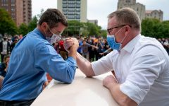 During a faculty arm wrestling tournament at the homecoming assembly Sept. 23 on Jackman Field, Daniel Calleri and Daniel Bobo-Jones competed first. Photo by Andrew Burke-Stevenson.