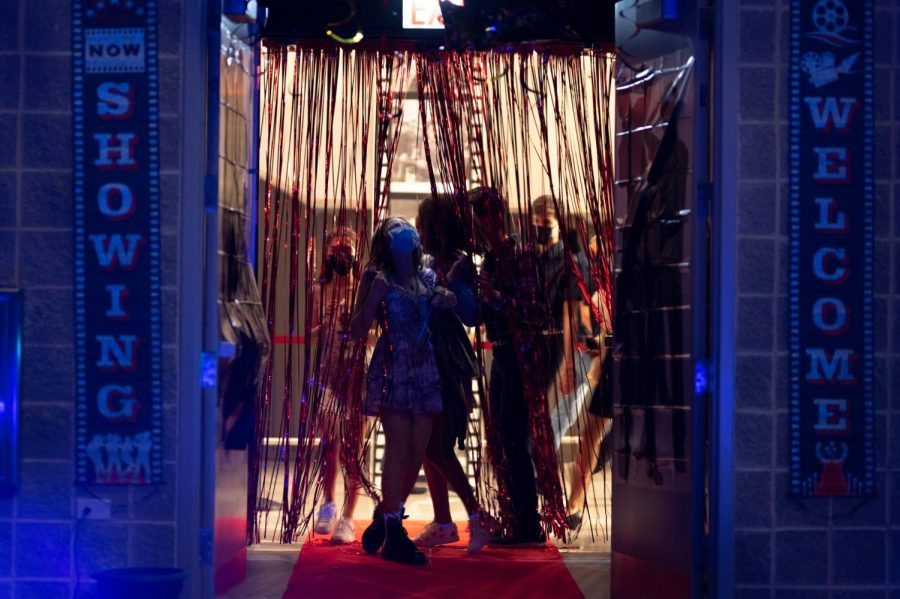 Pushing aside the red streamers that decorated the doorway, students enter Sherry Lansing theater to join the dance.