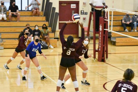 Sophomore Ella Cohen-Richie sets the ball during a varsity game against Lake Forest Academy on Sept. 14.
